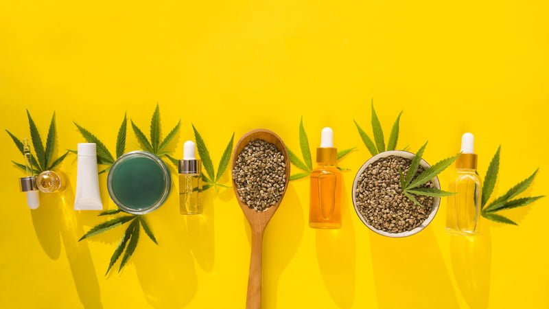 Delta 8 THC Products in Line with Hemp Leaves Yellow Background