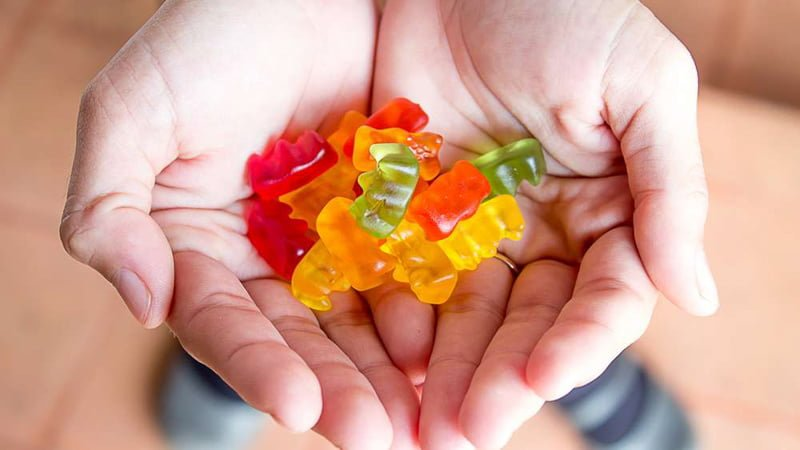 THC Gummies on the Hands