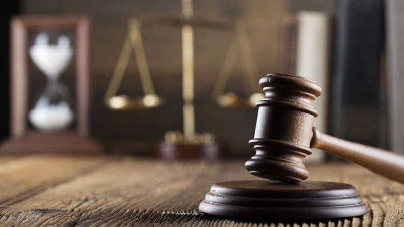 Gavel on the Wooden Surface and Justice Scale on the Background