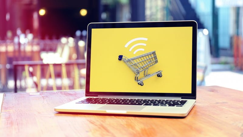 Online Shopping Concept - Cart on the Laptop Screen