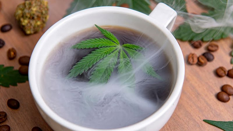cup of hot brewed coffee with hemp leaf