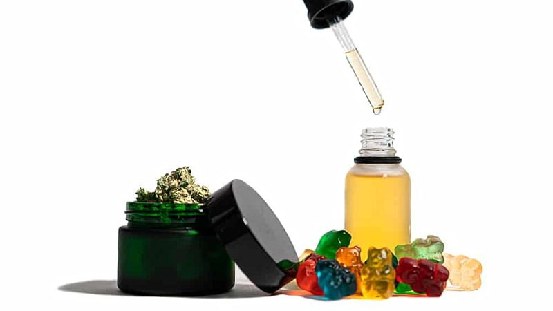 Delta 8 THC oil in bottle with dropper, gummies, and hemps in a bottle with white background